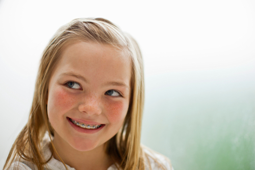 Image of young blonde girl wearing braces.